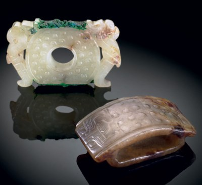 A WHITE JADE FITTING