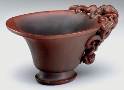 A RHINOCEROS HORN CUP
