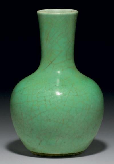 A SMALL APPLE-GREEN-GLAZED VAS