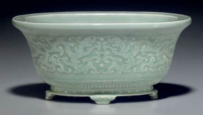 A SMALL FINELY MOLDED CELADON-