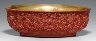 A RARE MOLDED FAUX CARVED RED
