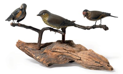 A CARVED AND PAINTED BIRD TREE