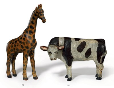 A CARVED AND PAINTED GIRAFFE