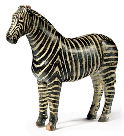 A CARVED AND PAINTED ZEBRA