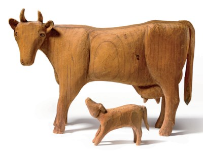 A CARVED PINE COW WITH CALF