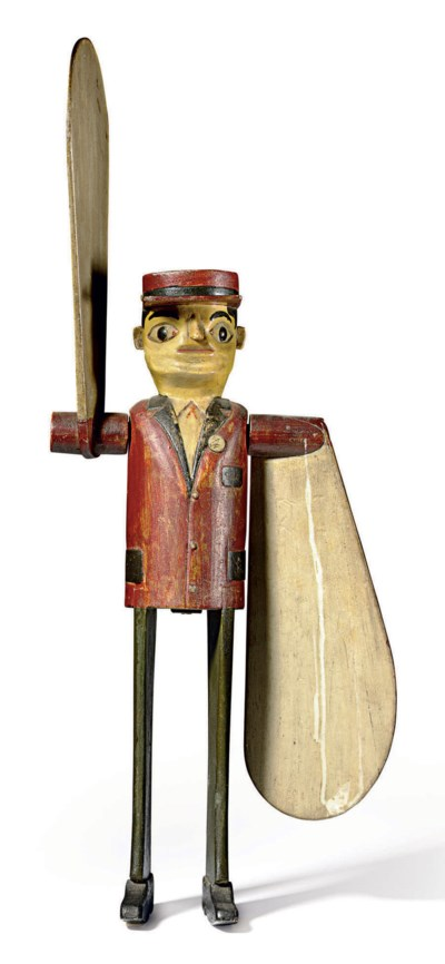 A CARVED AND PAINTED POLICEMAN