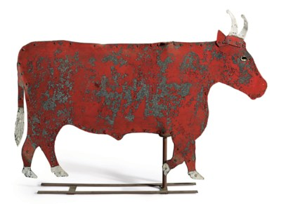A RED-PAINTED CUT-TIN BULL WEA