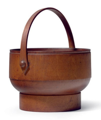 A TURNED TREEN-HANDLED FOOTED