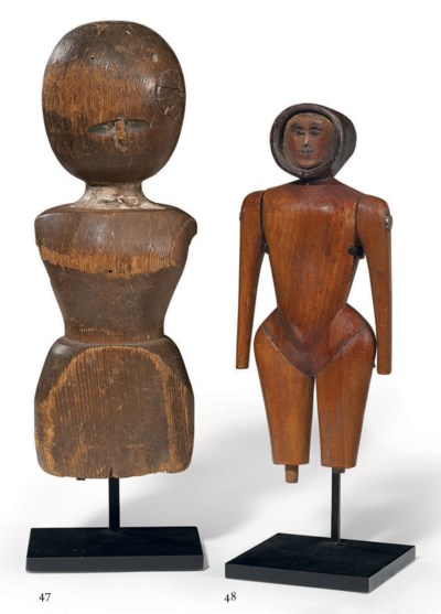 A CARVED PART-DOLL