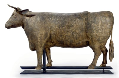 A GILT-COPPER MOLDED COW WEATH