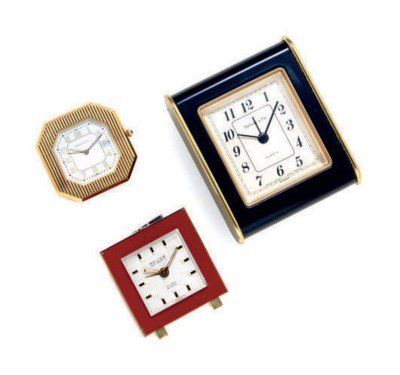 A GROUP OF TRAVEL CLOCKS