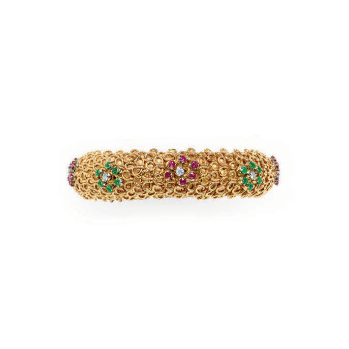 A MULTI-GEM AND 18K GOLD BRACE