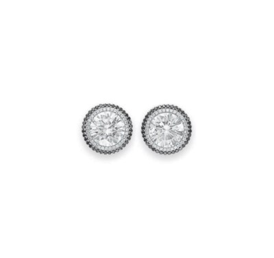 A PAIR OF DIAMOND STUDS