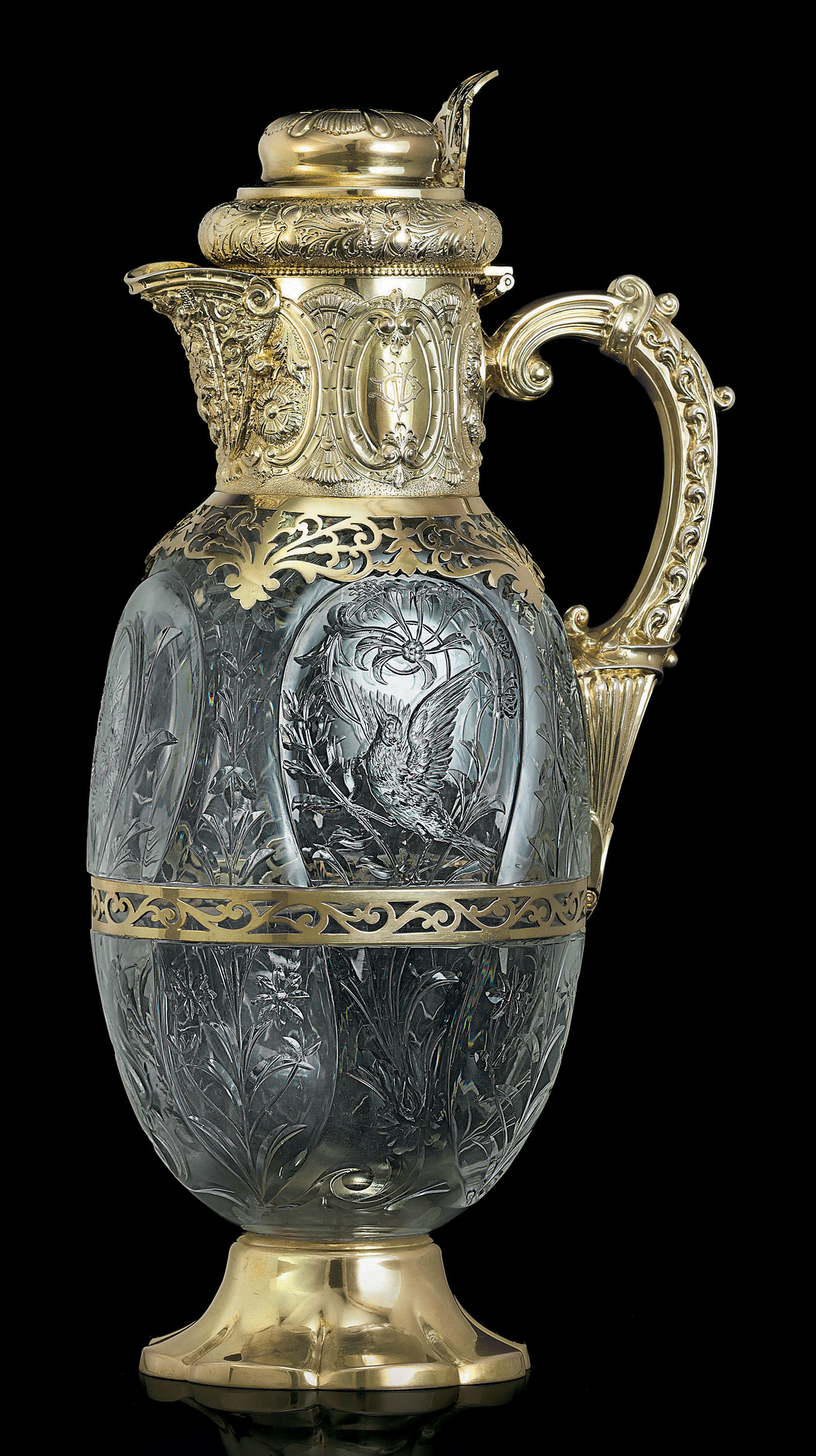 A VICTORIAN SILVER-GILT AND GLASS CLARET JUG