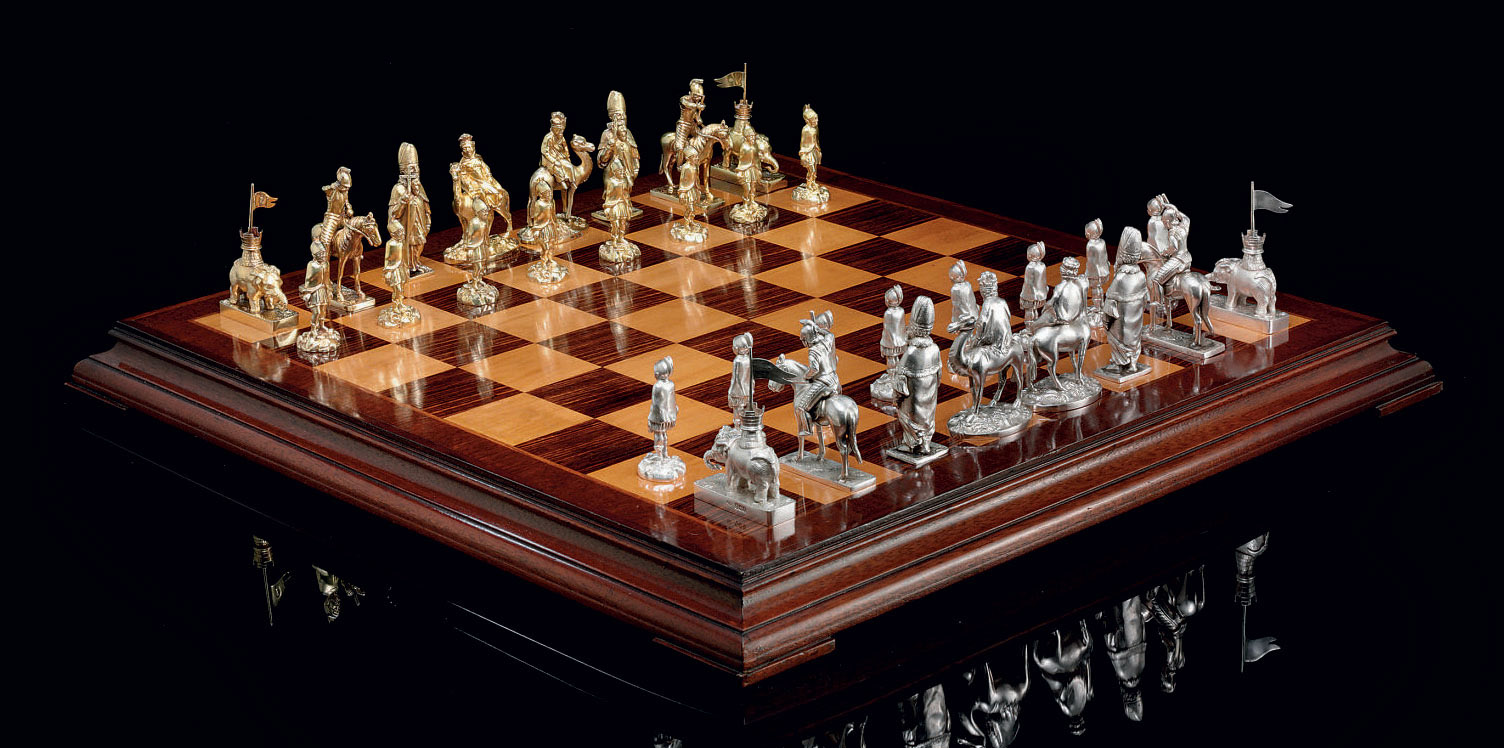 A RARE REGENCY SILVER AND SILVER-GILT CHESS SET