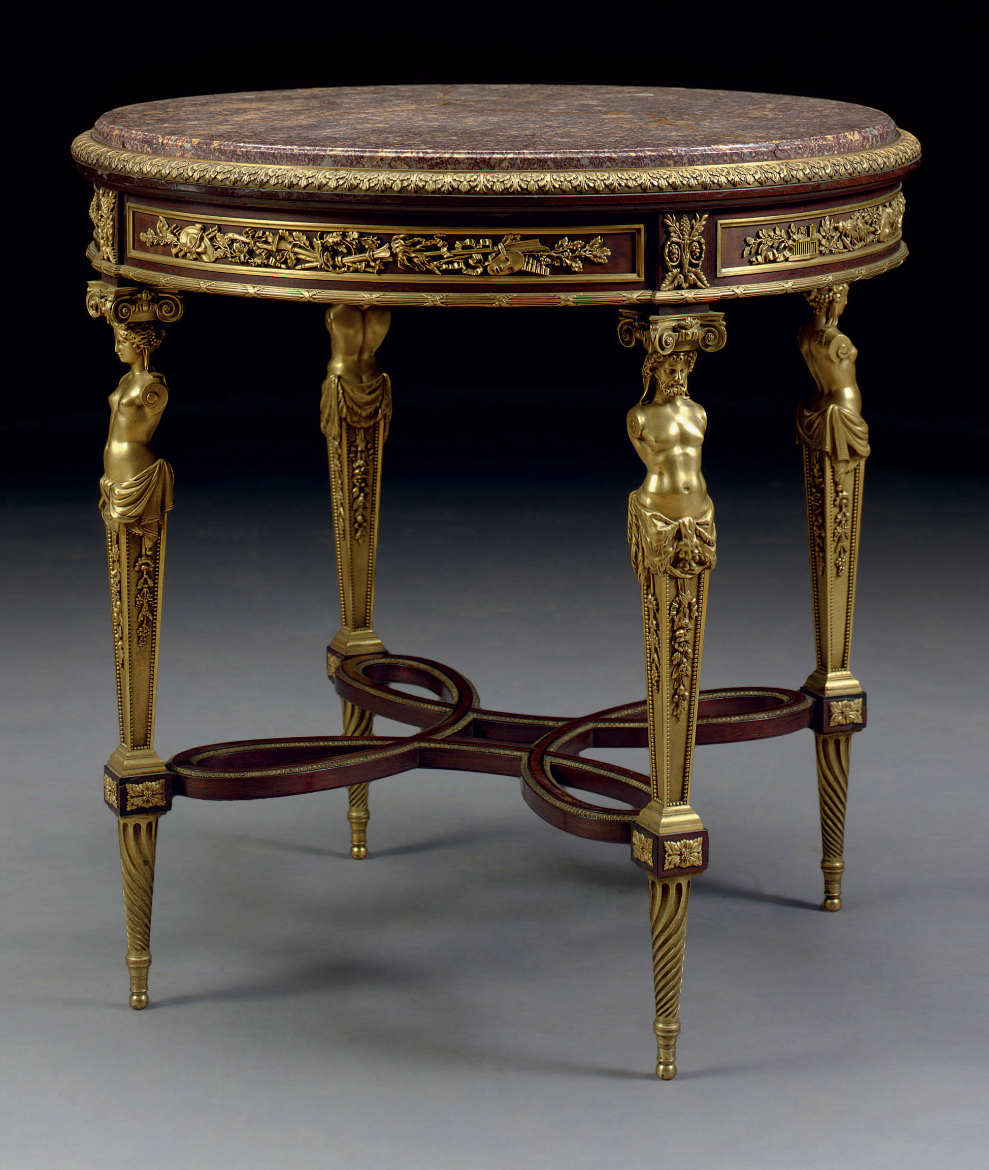 A FRENCH ORMOLU-MOUNTED MAHOGANY CENTER TABLE