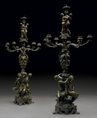 A PAIR OF FRENCH PATINATED BRONZE NINE-LIGHT CANDELABRA (CANDELABRES A NEUF LUMIERES, DECORES DE SIX FIGURES, MASCARONS ET CHIMERES)