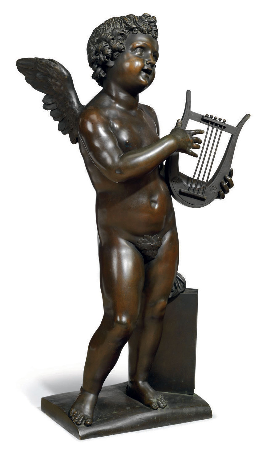 A FRENCH PATINATED BRONZE FIGURE OF CUPID