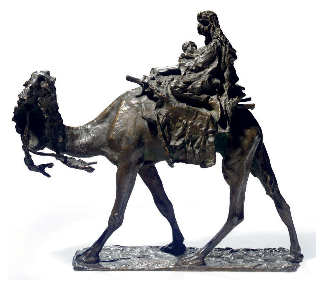AN ITALIAN PATINATED BRONZE FIGURAL GROUP OF WOMAN AND CHILD ON A CAMEL