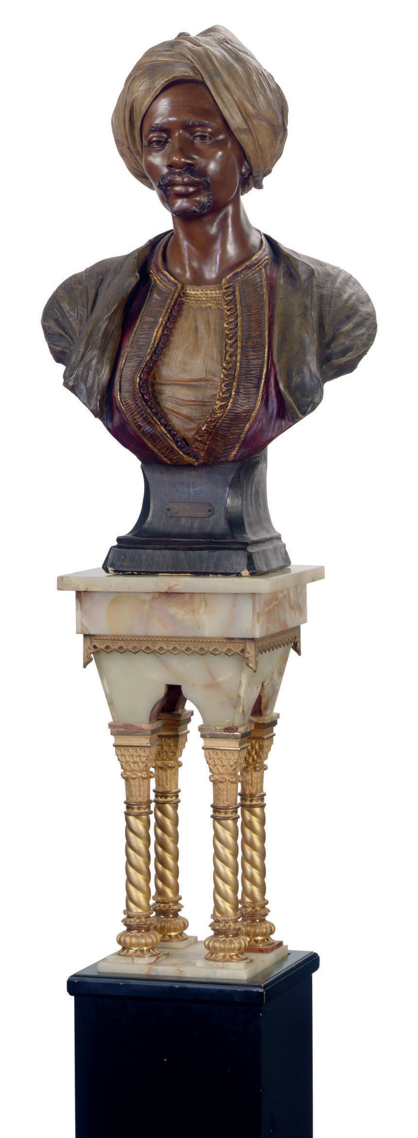 AN AUSTRIAN POLYCHROME-PATINATED TERRACOTTA BUST OF A MOOR ENTITLED 'LE MAHDI', ON PEDESTAL