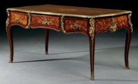 A LOUIS XV ORMOLU-MOUNTED TULIPWOOD, AMARANTH AND FLORAL MARQUETRY BUREAU PLAT