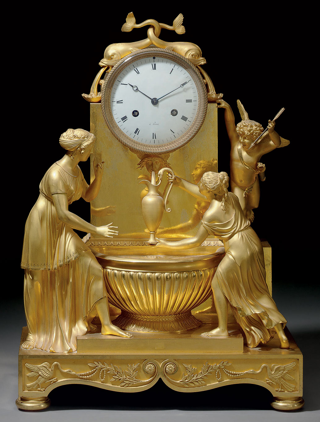 AN EMPIRE ORMOLU STRIKING MANTEL CLOCK: 'PENDULE A LA FONTAINE'
