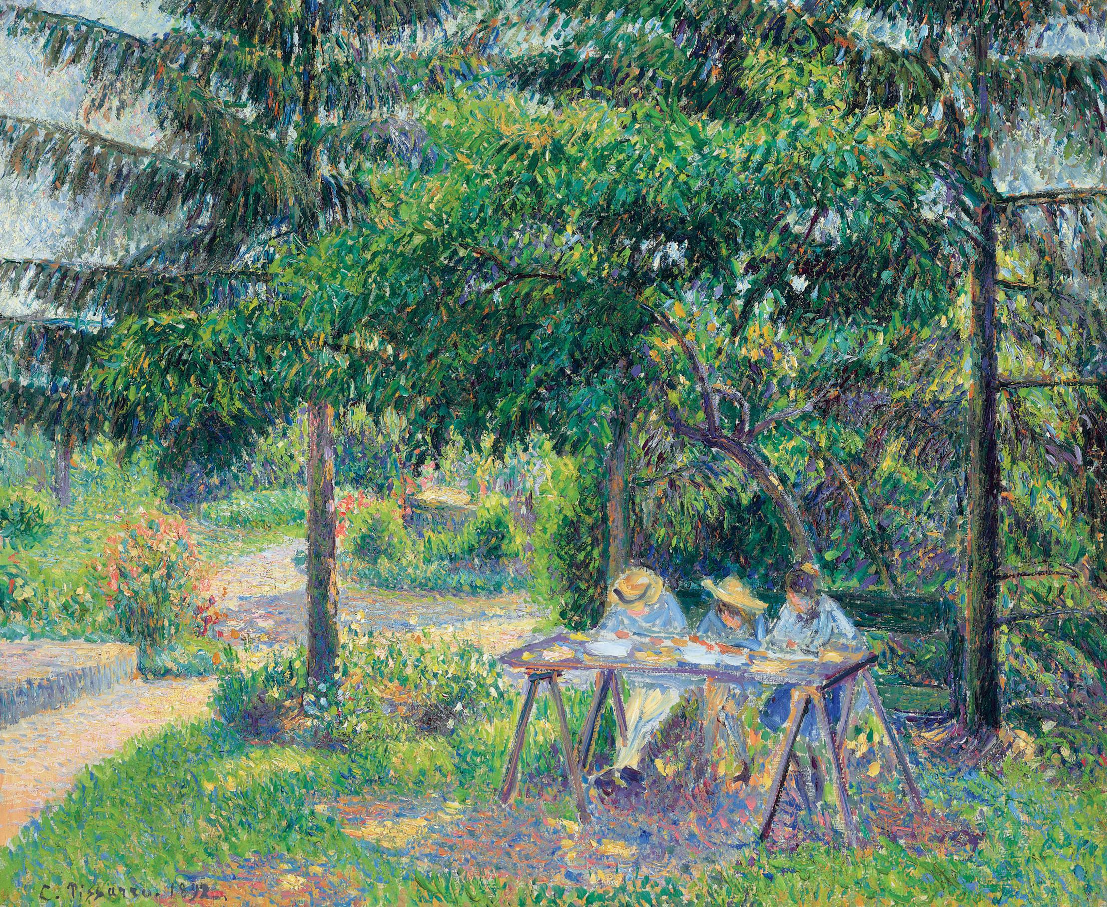 Enfants attablés dans le jardin à Eragny