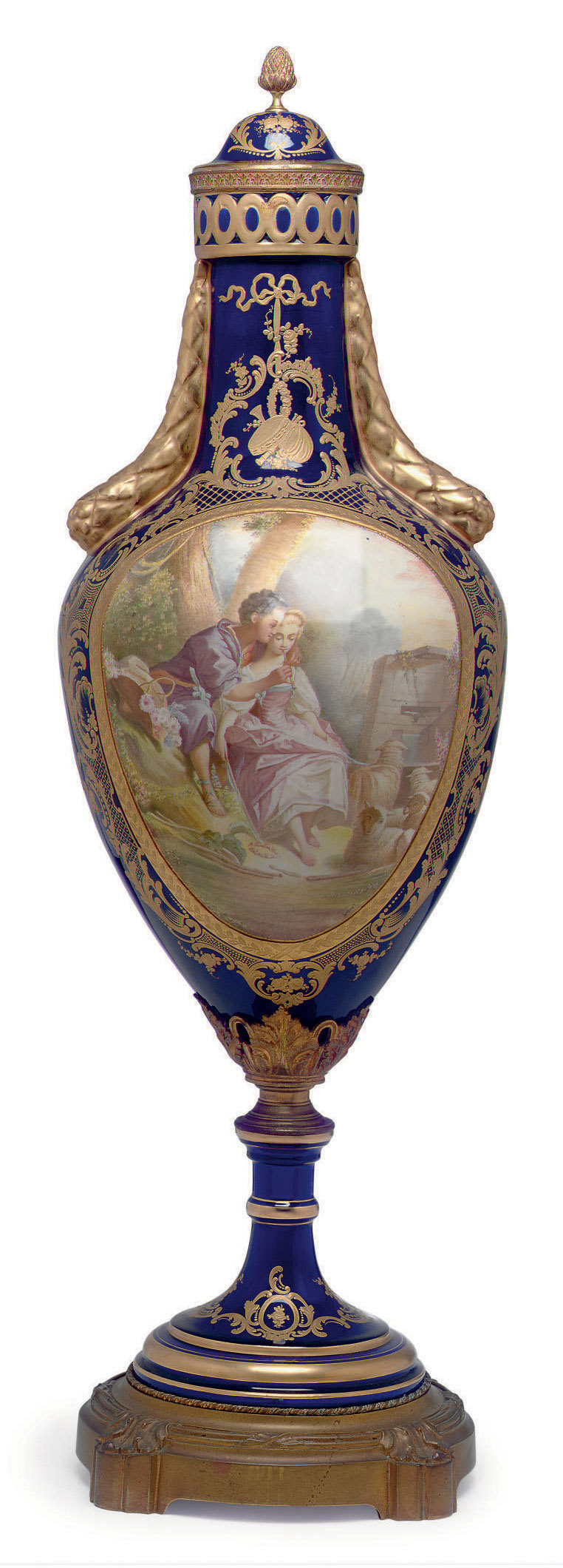 A LARGE ORMOLU-MOUNTED SEVRES STYLE PORCELAIN COBALT-BLUE GROUND VASE AND COVER