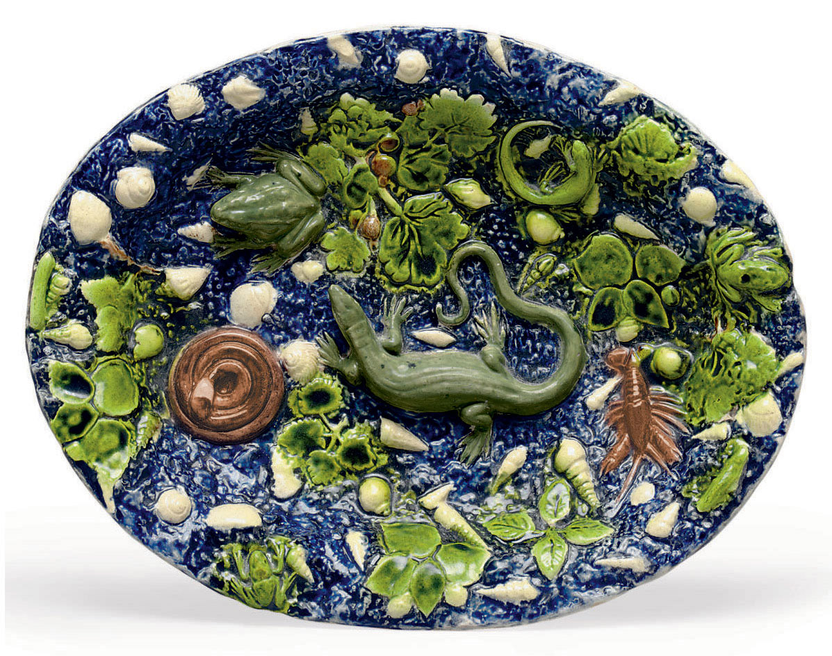 A FRENCH FAIENCE FINE TROMP L'