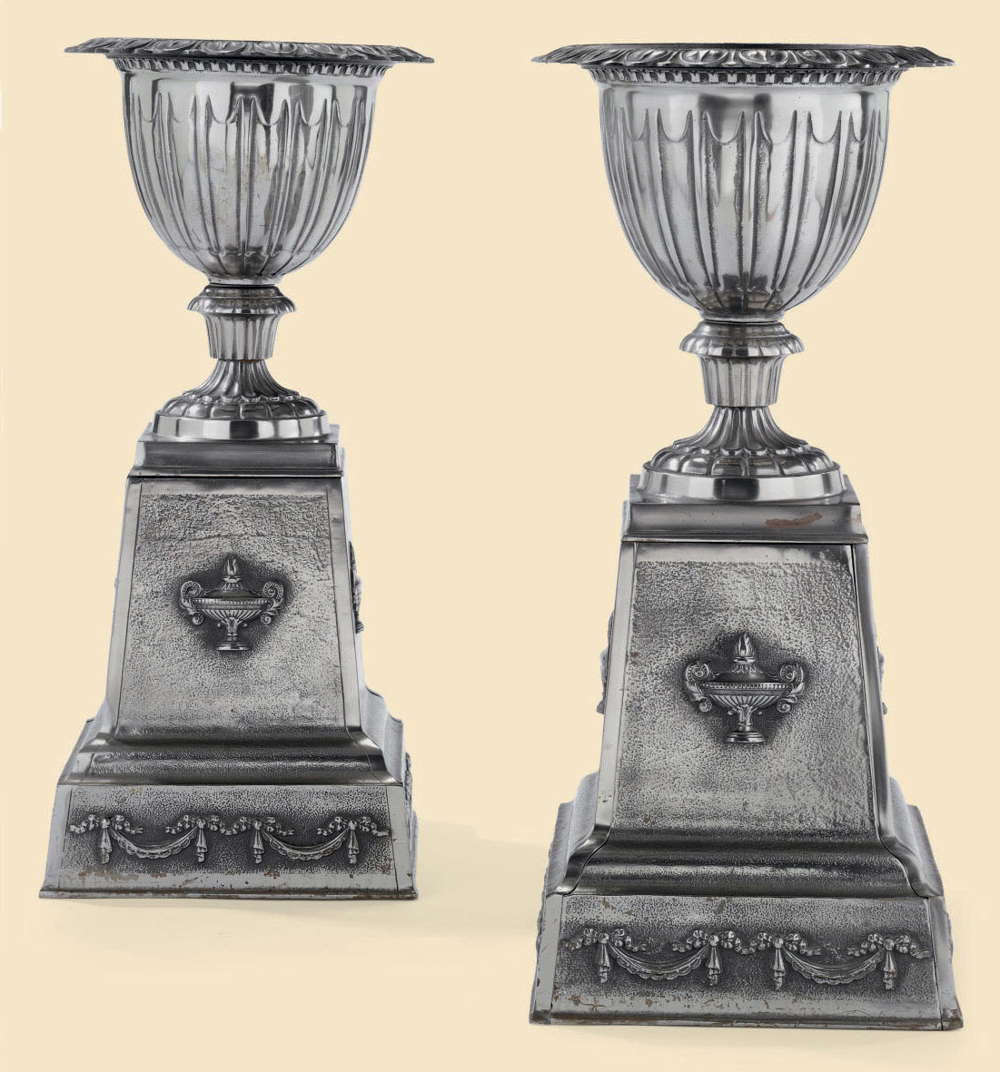 A PAIR OF POLISHED CAST-METAL