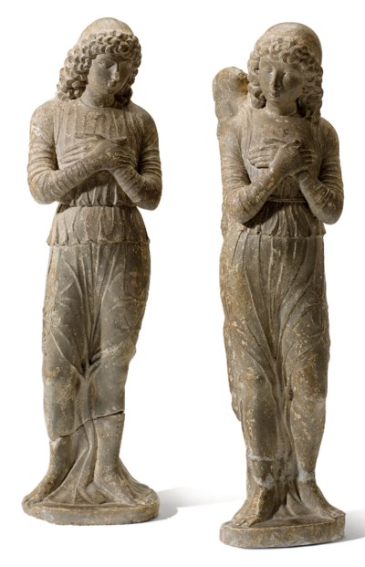 A PAIR OF CARVED LIMESTONE FIG