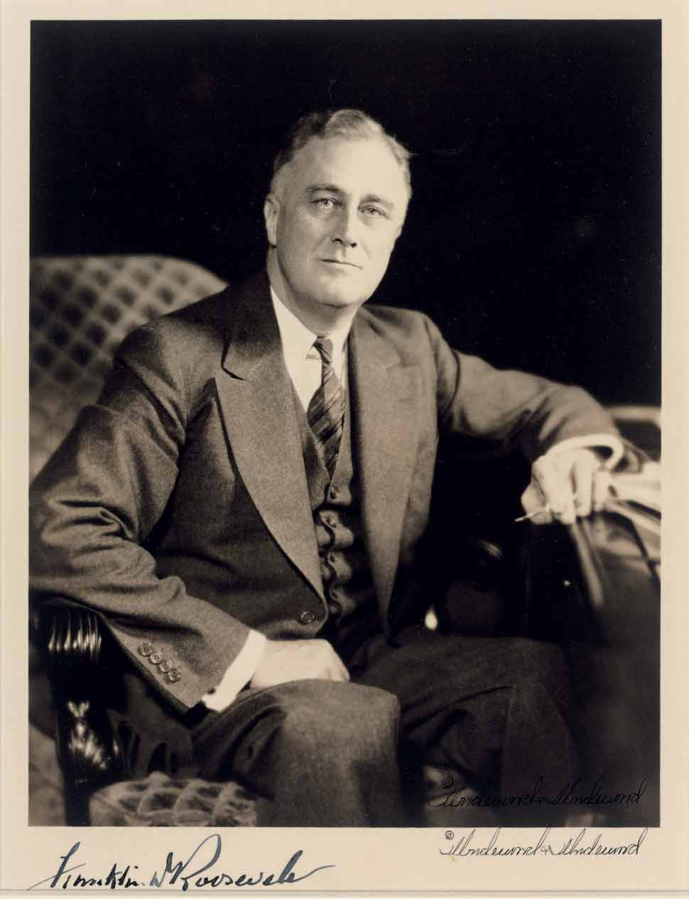 "ROOSEVELT, Franklin D. (1882-1945), President. Photograph signed (""Franklin D. Roosevelt""), n.d. [ca. 1933]. Underwood & Underwood, photographer. Black and white photographic portrait (9x7in.), matted and framed in a museum quality frame. Signed on lower edge of the matt."