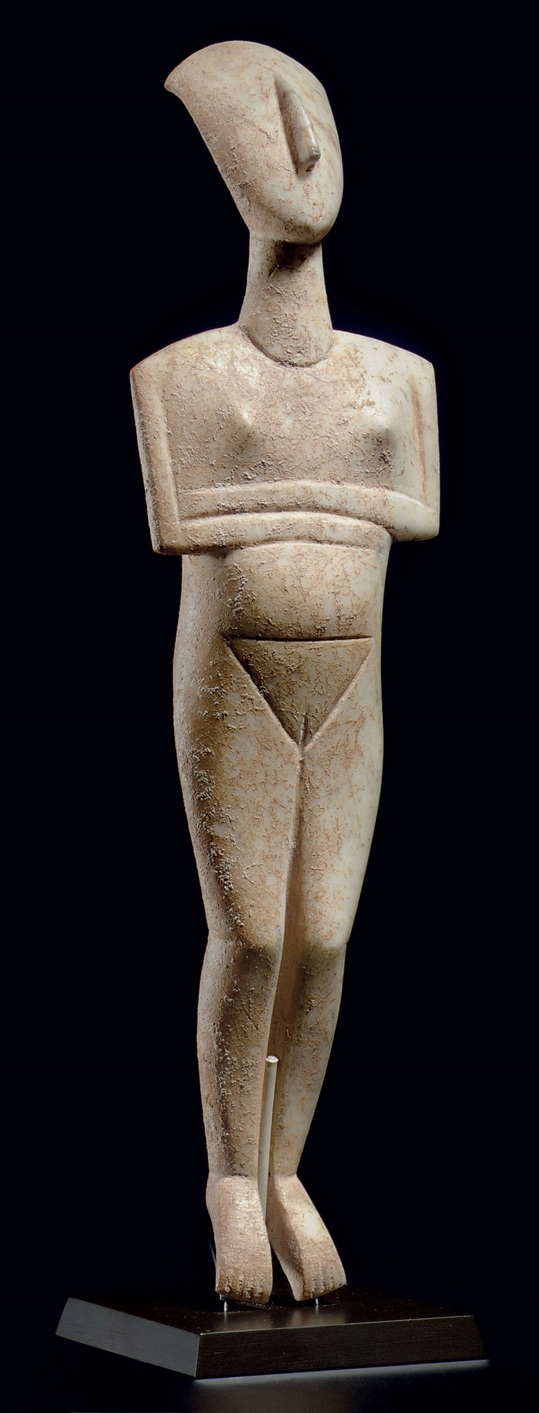 A Cycladic marble reclining female figure, name-piece of the Schuster Master, early Cycladic II, circa 2400 BC. 11½  in (29.2  cm) high. Sold for $16,882,500 on 9 December 2010 at Christie's in New York
