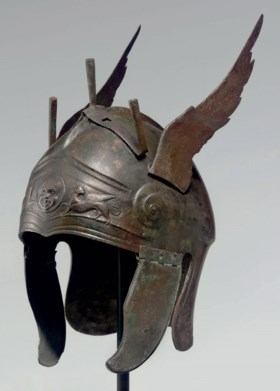 A GREEK BRONZE WINGED HELMET OF CHALCIDIAN TYPE