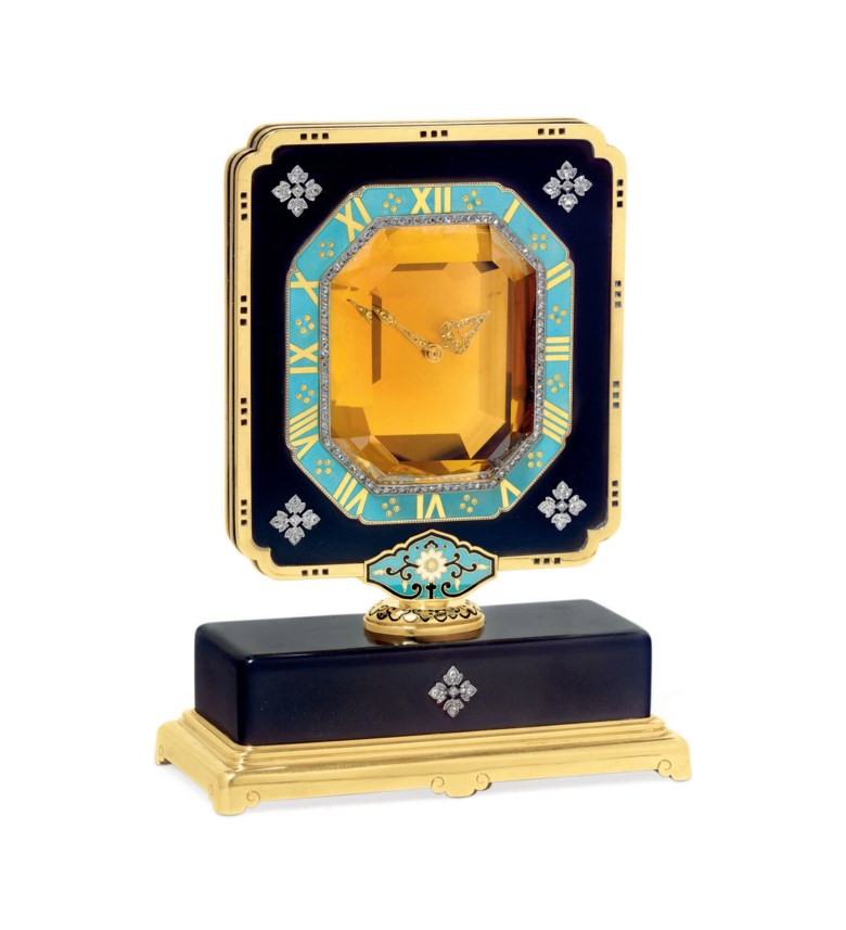 An exceptional Art Déco citrine, ebonite, diamond and enamel 'Mystery' clock, by Cartier. Sold for $710,500 on 7 December 2010 at Christie's in New York