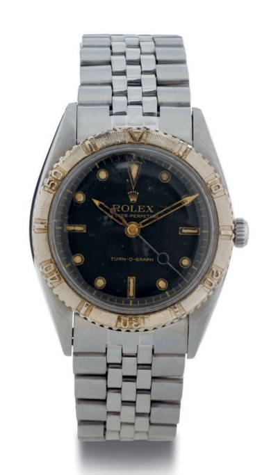 ROLEX. A STAINLESS STEEL AND G