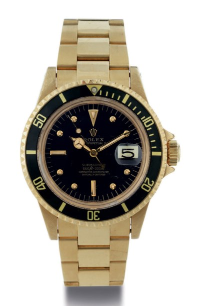 ROLEX. AN 18K GOLD AUTOMATIC W