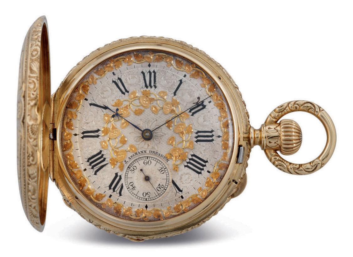 J. ASSMANN. A FINE 18K GOLD HUNTER CASE KEYLESS LEVER POCKET WATCH WITH RICHLY ENGRAVED CASE