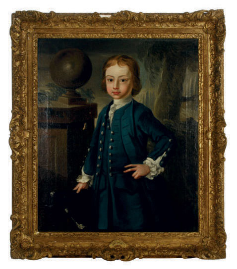 Portrait of a young boy wearing a blue coat, standing in a landscape
