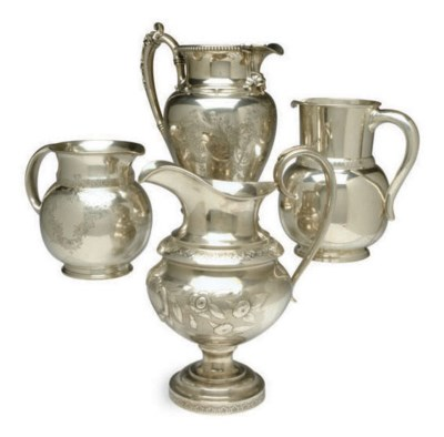 FOUR AMERICAN SILVER PITCHERS,