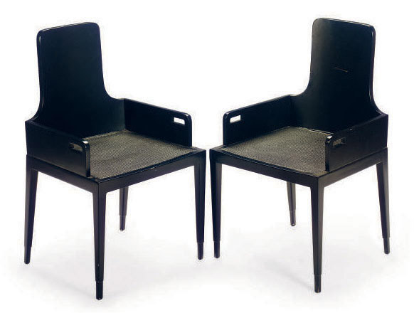A SET OF EIGHT BLACK LACQUERED AND CANED ARMCHAIRS,