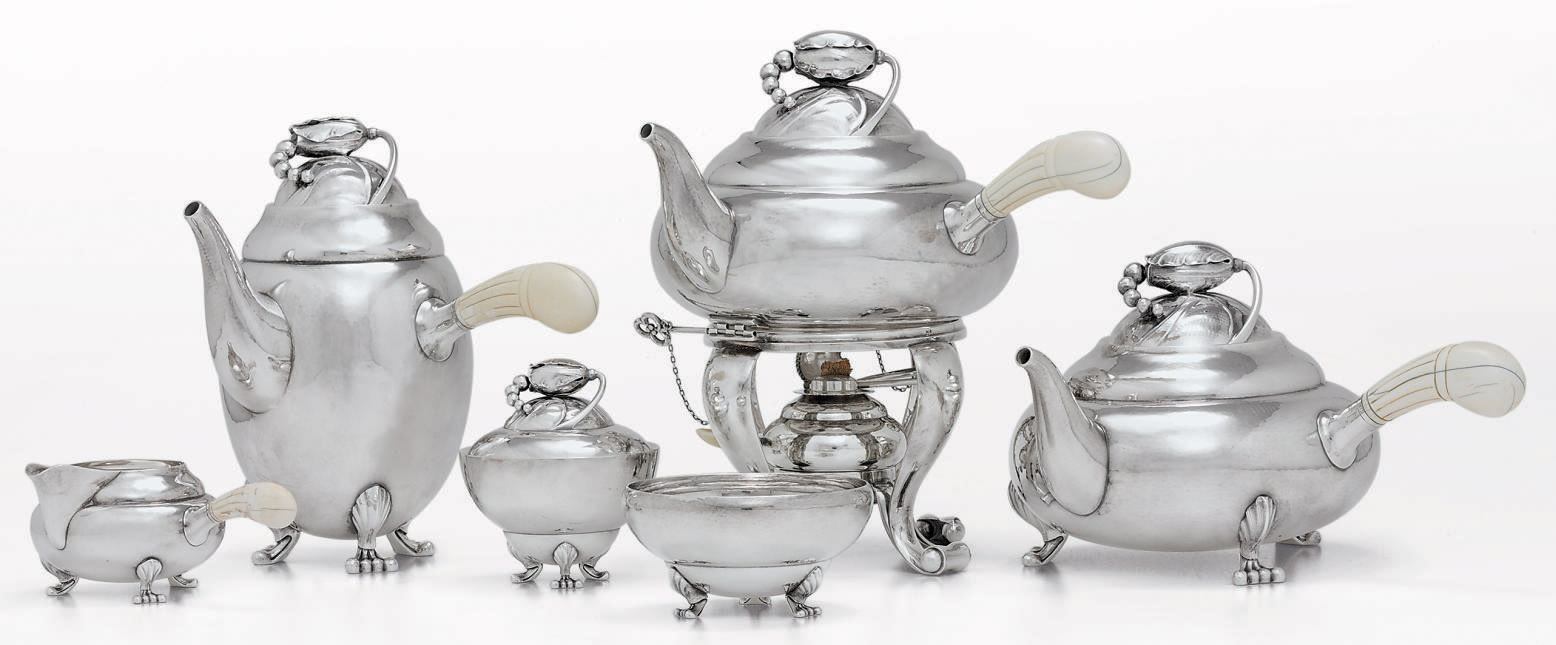 A DANISH SILVER SIX-PIECE TEA AND COFFEE SERVICE DESIGNED BY GEORG JENSEN**