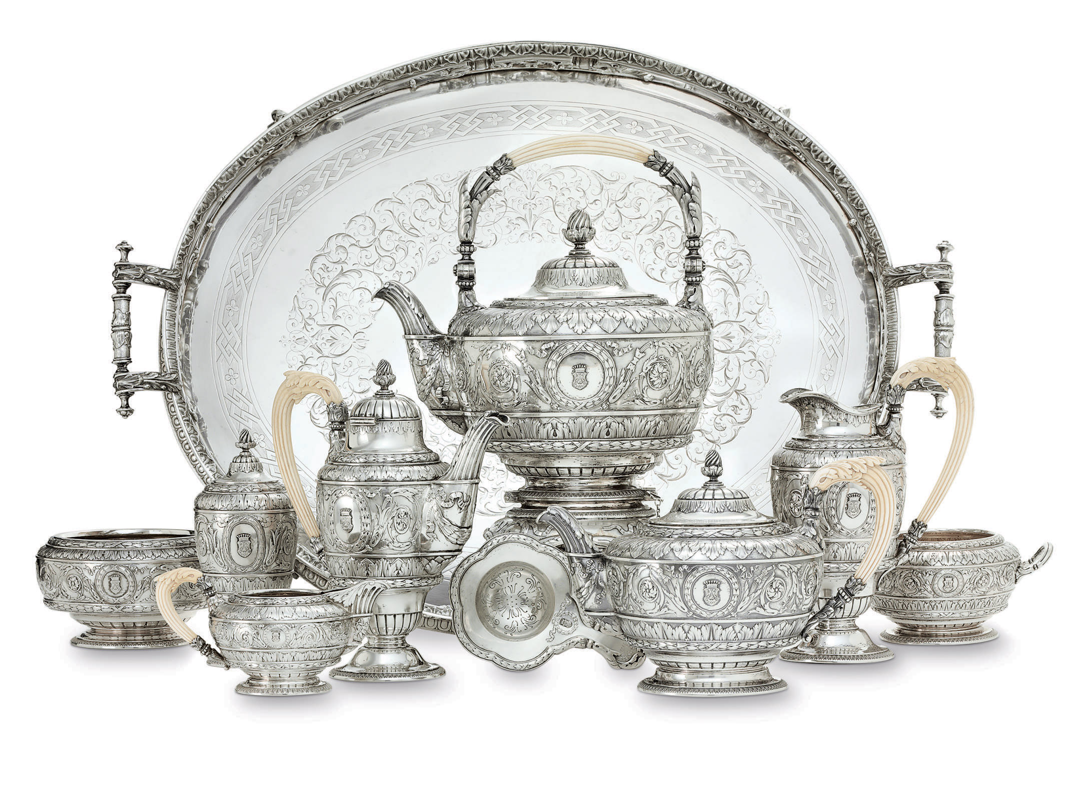 AN AUSTRIAN SILVER SEVEN-PIECE TEA AND COFFEE SERVICE WITH SILVER-PLATED TRAY**