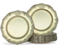A SET OF TWELVE REGENCY SILVER-GILT DINNER PLATES