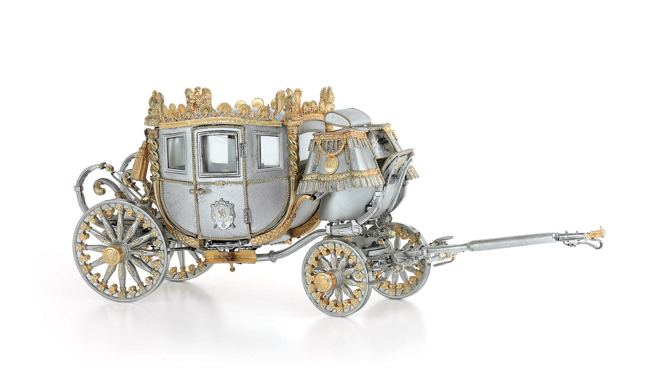 AN AMERICAN PARCEL-GILT SILVER MODEL OF A CORONATION COACH
