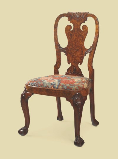 A GEORGE II FIGURED WALNUT SID