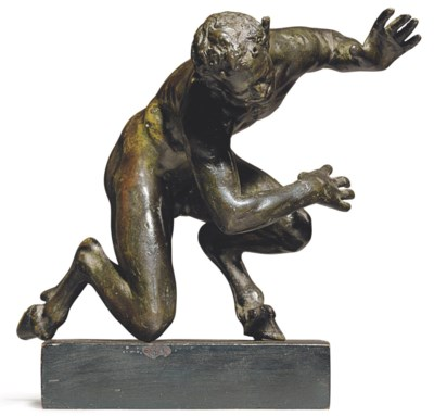 A BRONZE FIGURE OF A CROUCHING