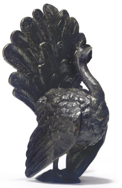 A BRONZE MODEL OF A PEACOCK