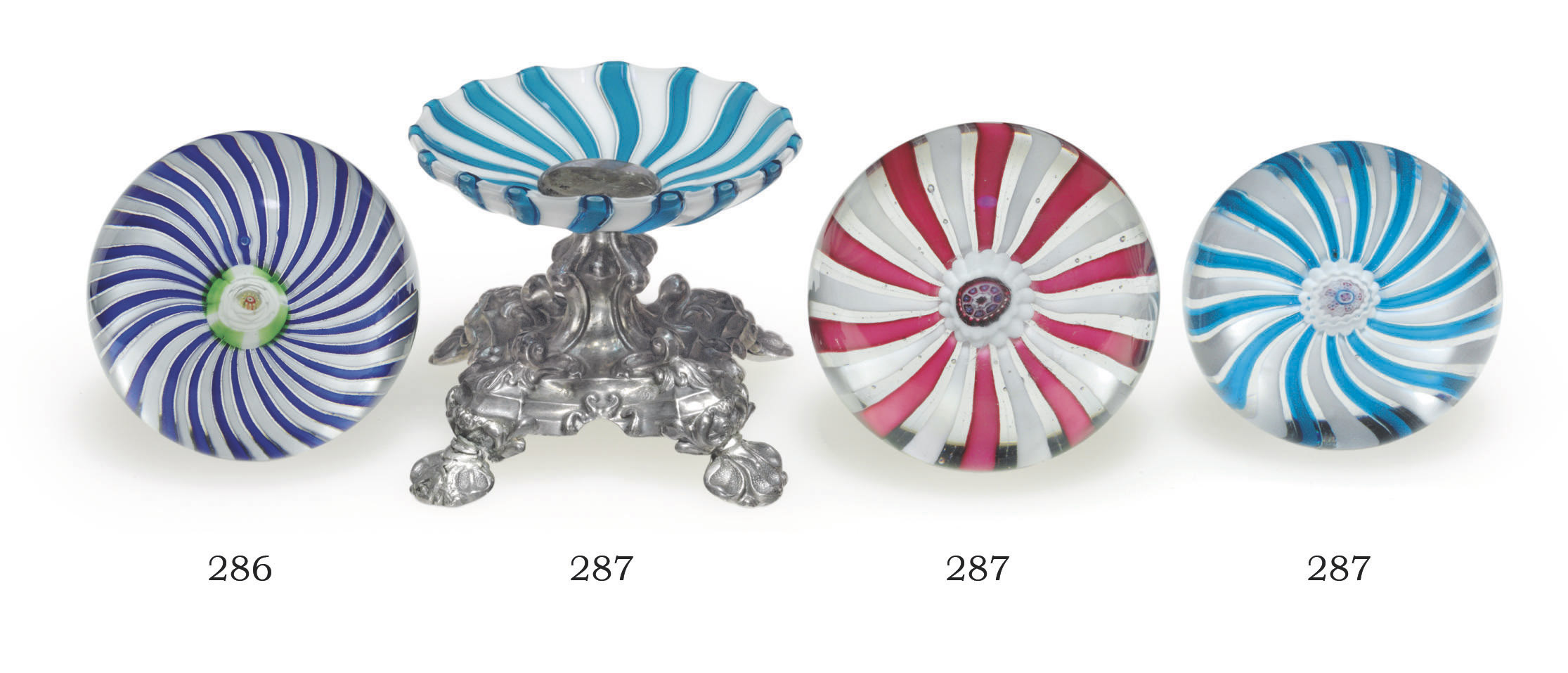 TWO CLICHY GLASS SWIRL WEIGHTS AND A RELATED TAZZA