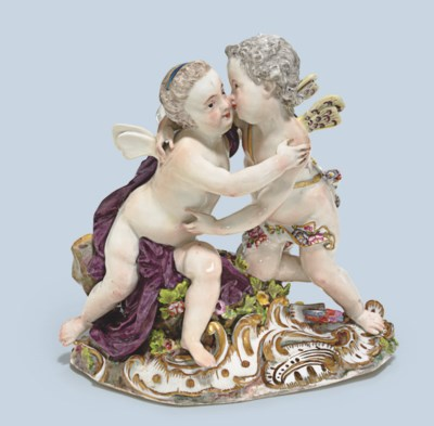 A MEISSEN GROUP OF CUPID AND P